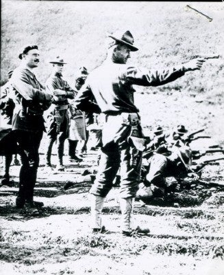 U.S. Army Officer training with a 1911 pistol circa 1918 in France.