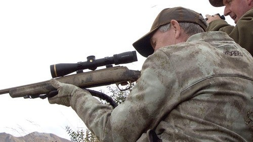 Hunter aiming an X-Bolt rifle.